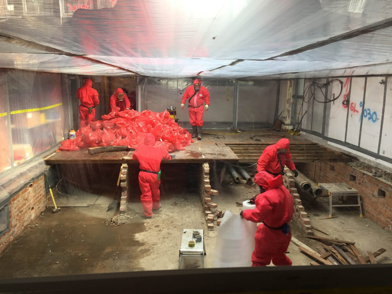 Asbestos removal workers on site